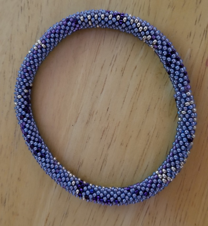 mauve roll on bracelet